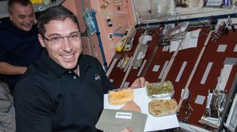 2078404_astronaut-mike-hopkins-with-thanksgiving-meal_e5hnf3hnpubhs2bvl7hyg6ti4tggiqn63zkcn5eeuqux54zcfvtq_757x425